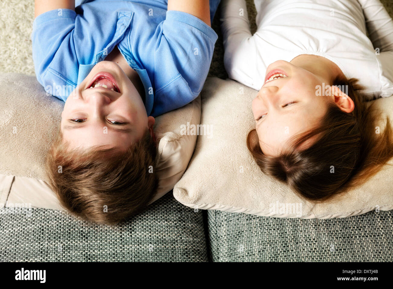 Children using tablet computer at home, having fun, Munich, Bavaria, Germany - Stock Image