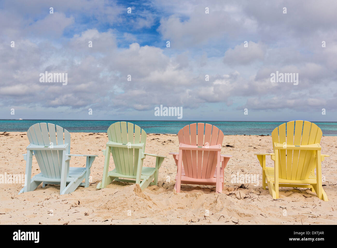 Charmant Pastel Colored Adirondack Chairs On Love Beach In Nassau, Bahamas