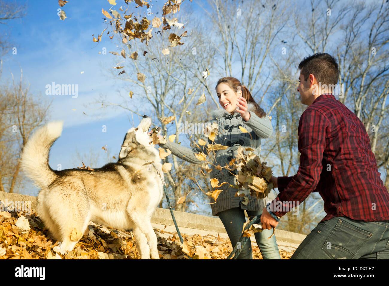Couple with Dog Outdoors, Croatia - Stock Image