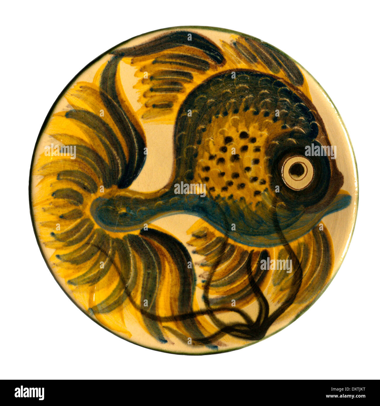 Plate with a fish design from the Puigdemont Studio in Catalonia - a typical 1950s holiday souvenir from Spain. - Stock Image