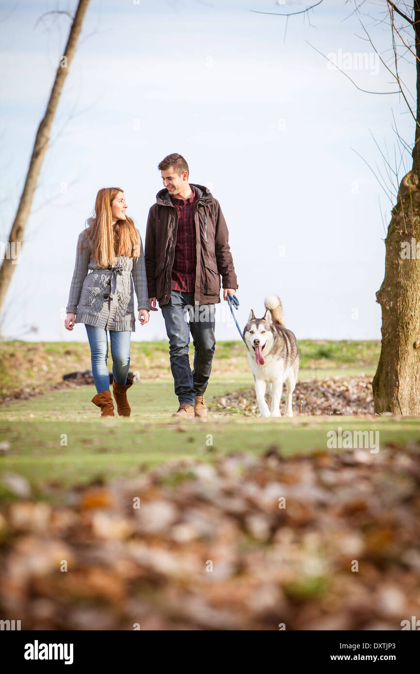 Couple Walking Dog Outdoors, Croatia - Stock Image