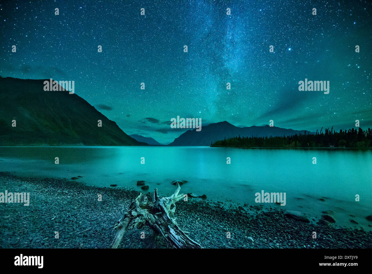 the Milky Way and night sky over Kathleen Lake & the St Elias Mountains, Kluane National Park, Yukon Territories, - Stock Image