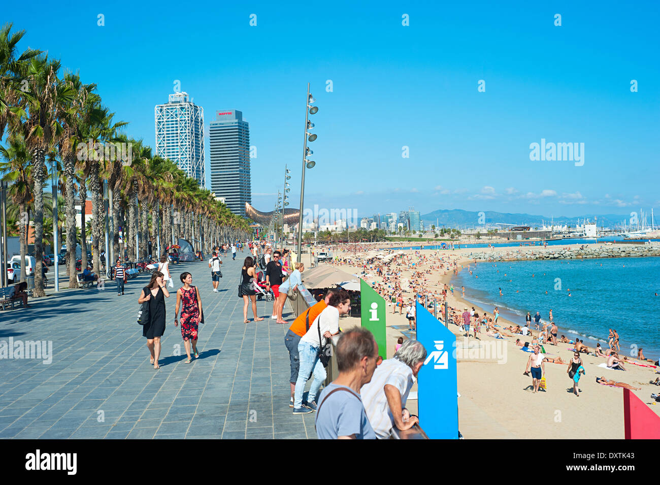 Unidentified people at Barcelona city beach. 400 meters long, it is one of 10 best urban beaches of the world. - Stock Image