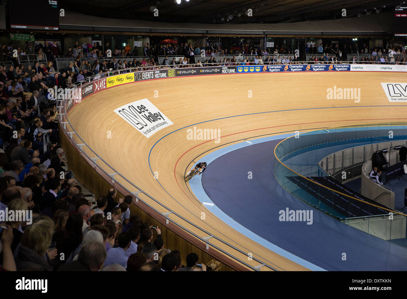 A cyclist races around the track at the London Olympic Velodrome - Stock Image