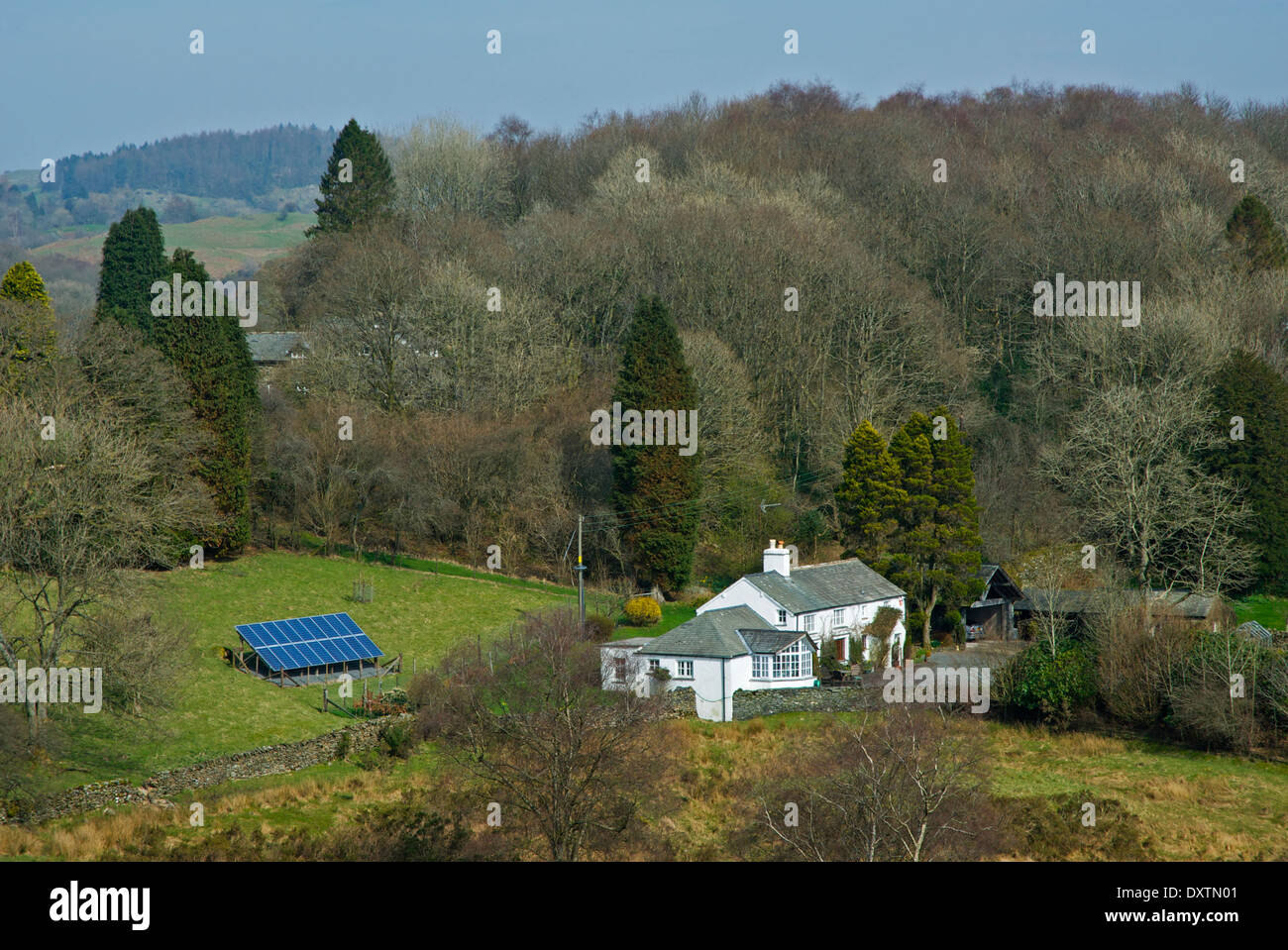 Ash Cottage, with solar panels, near Bowness, Lake District National Park, Cumbria, England UK - Stock Image