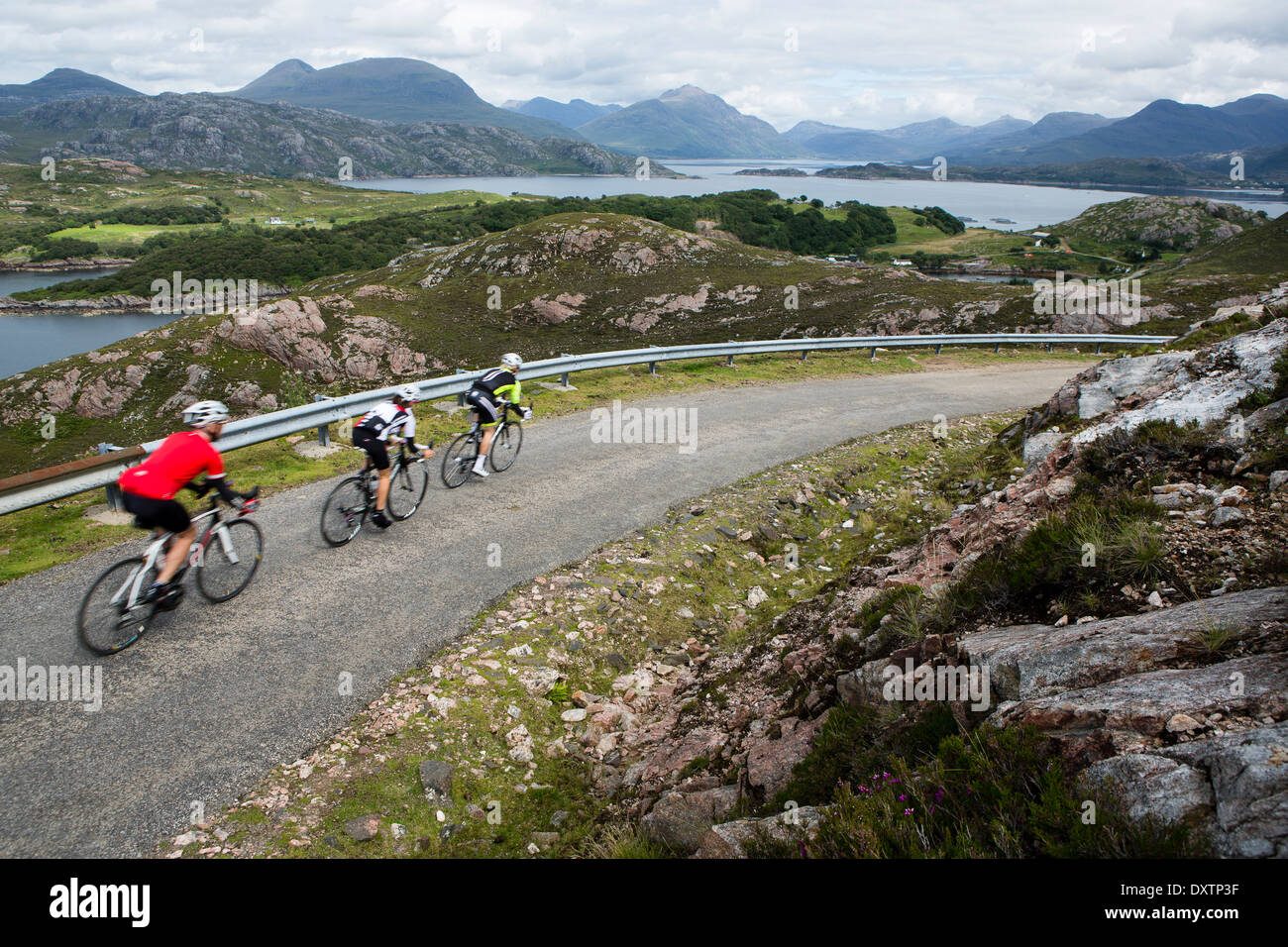 A cyclist takes on Britain's longest road climb in Lochcarron, Scotland - Stock Image