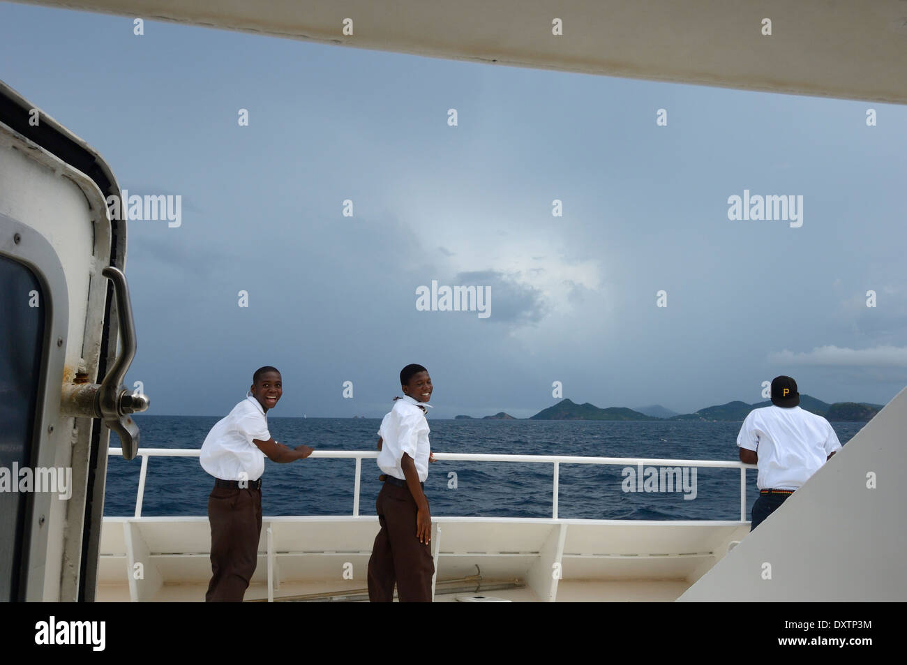 Local schoolboys on the deck of the Island ferry boat. Grenada - Stock Image