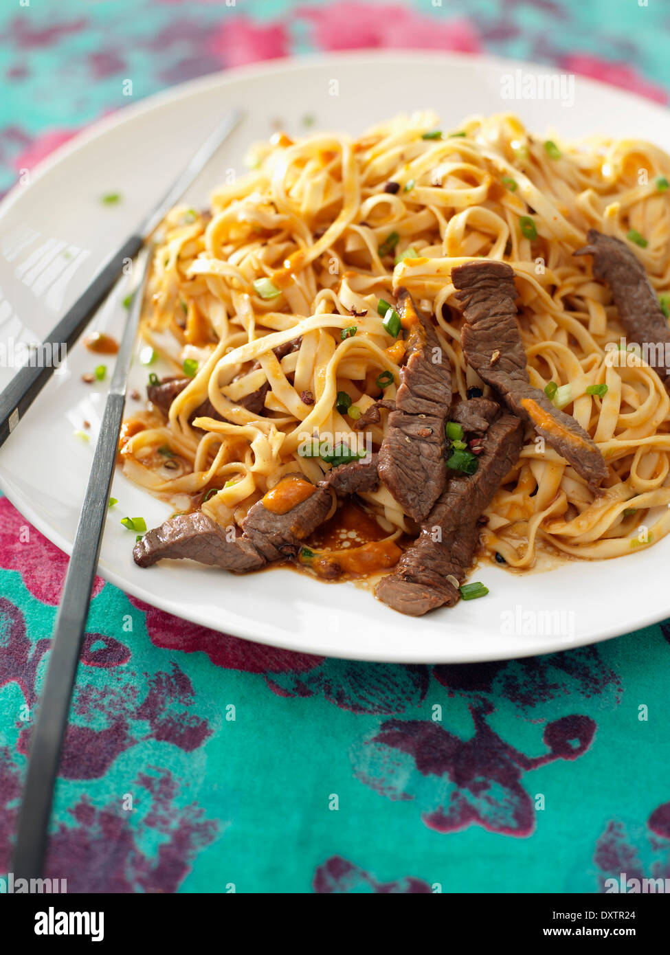 Asian noodles with beef - Stock Image