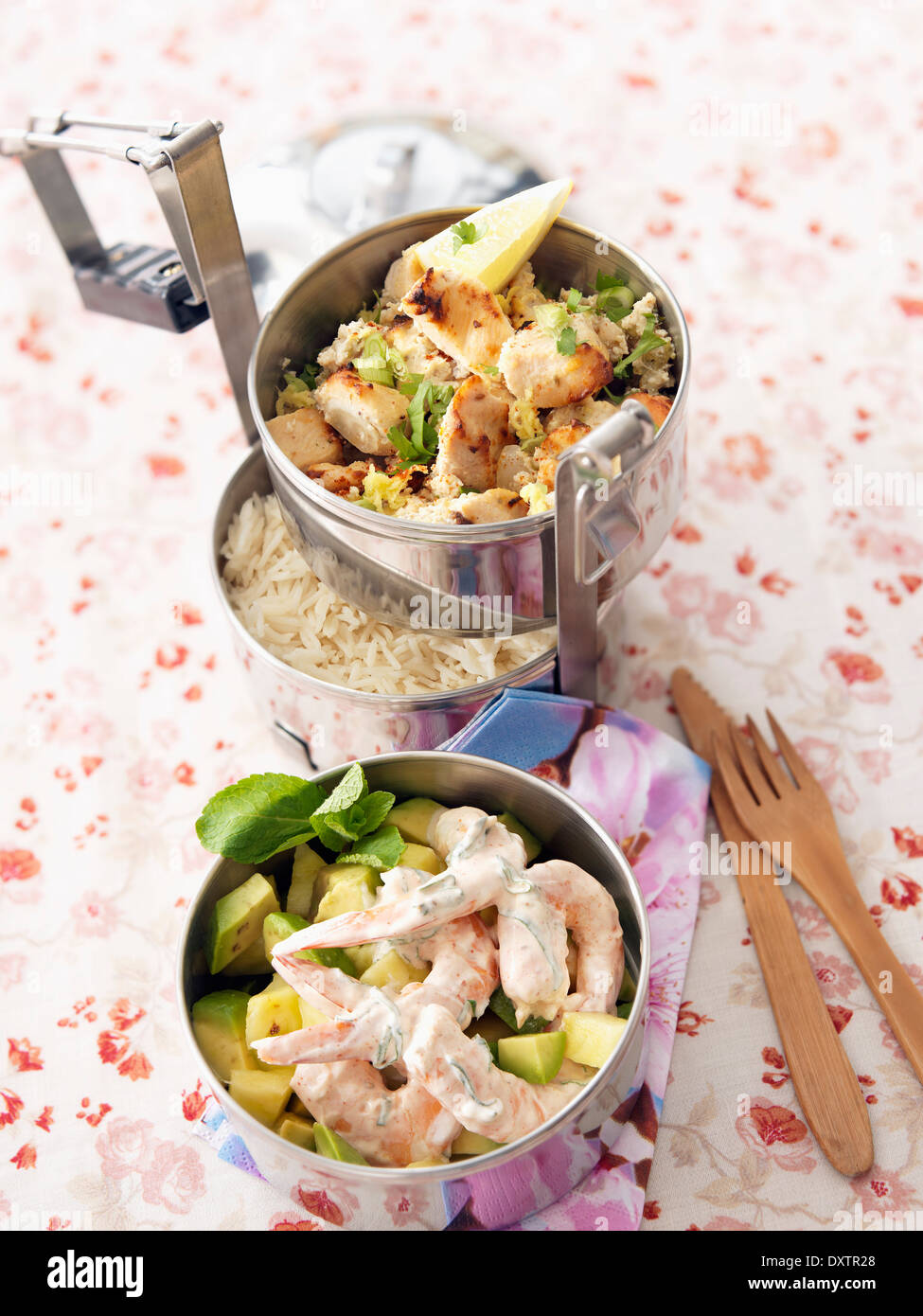 Shrimps marinated in yoghurt with avocado, grilled chicken with basmati rice - Stock Image
