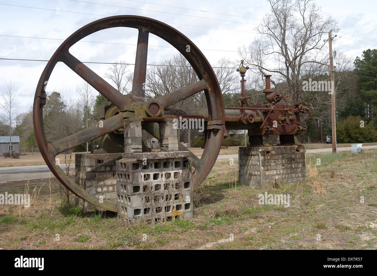 Remains of an old steam engine - Stock Image