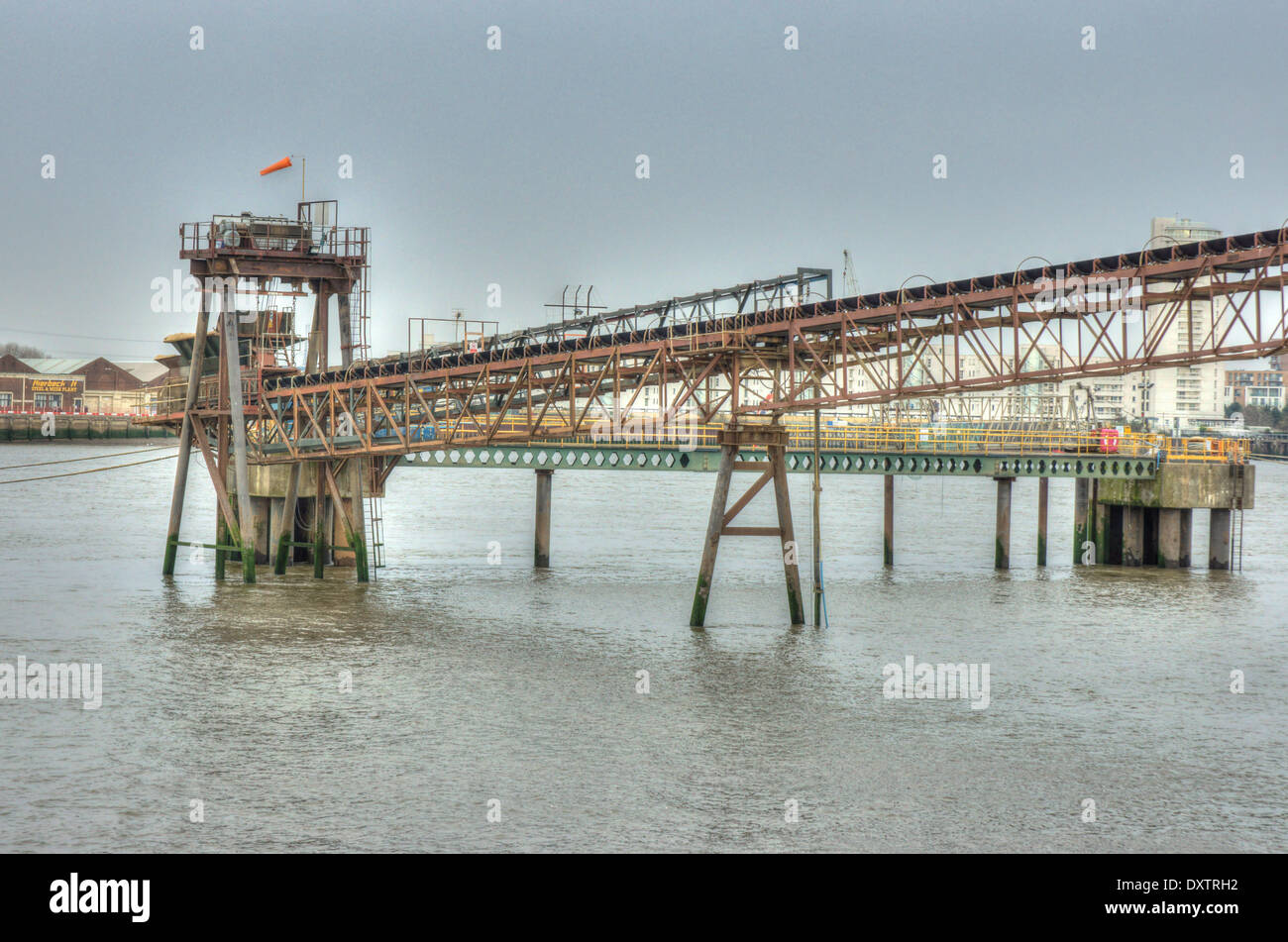 industrial conveyor belt on river Thames, London. - Stock Image