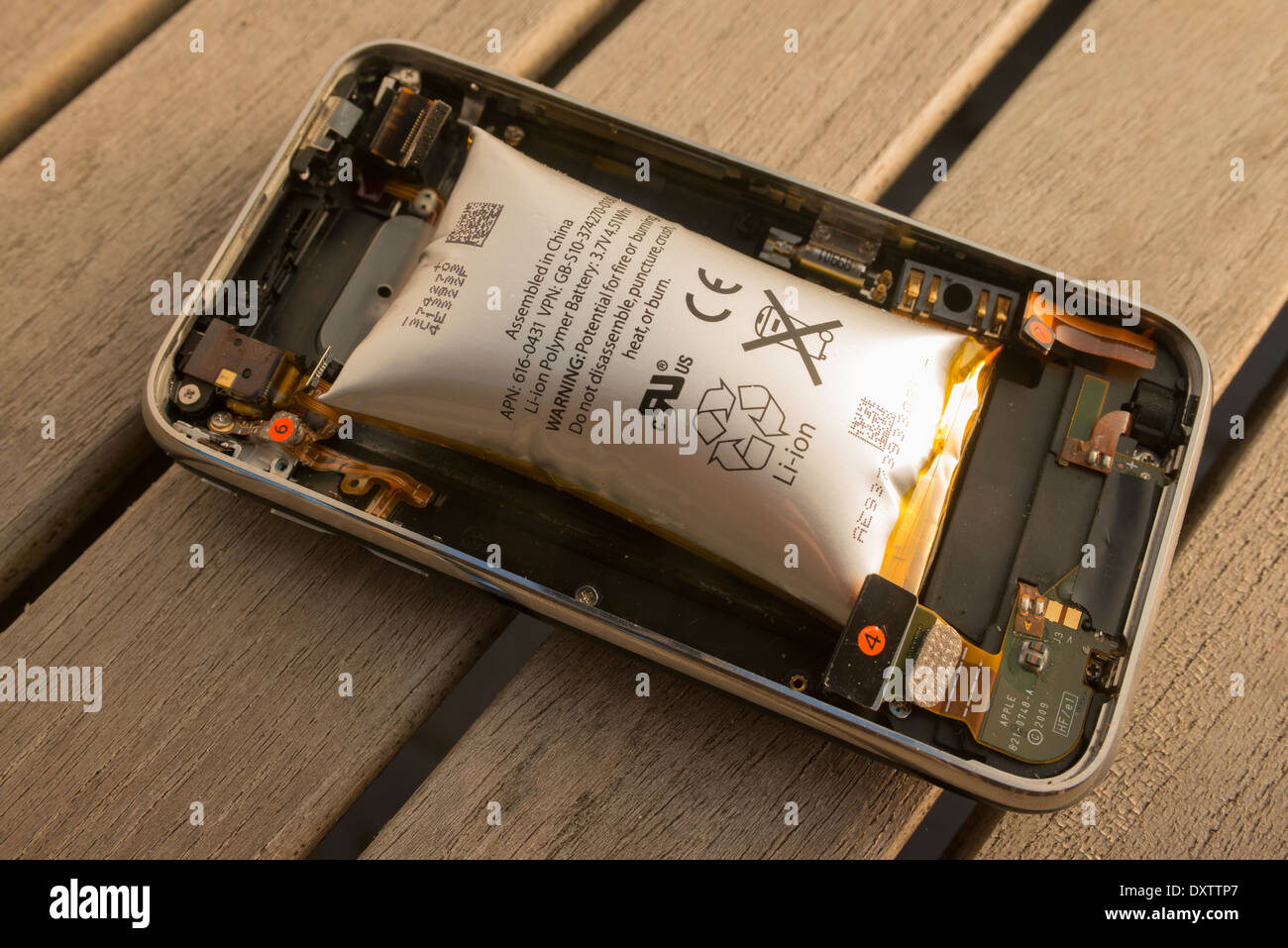Modern cellphone having suffered from damage due to Lithium Ion battery swelling - Stock Image