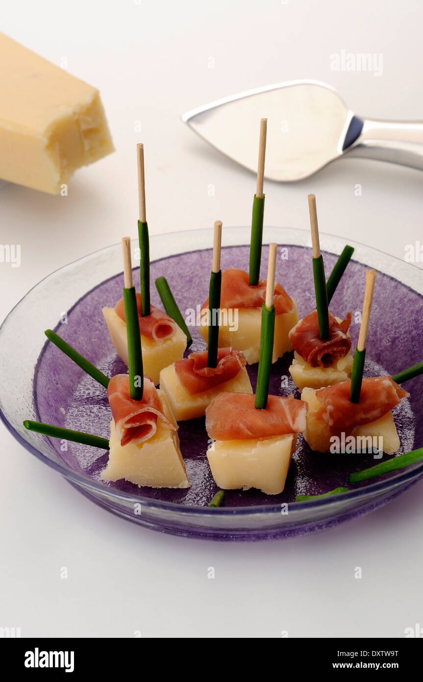Parmesan, serrano ham and chive bite-size appetizers - Stock Image