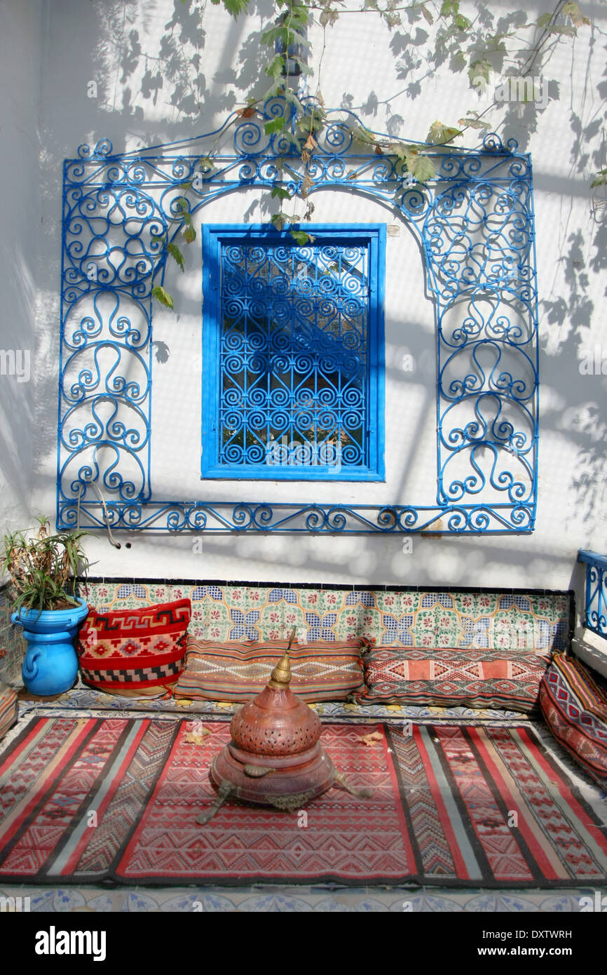 A resting place in the courtyard of a typical house in Sidi Bou Said,Tunisia. - Stock Image
