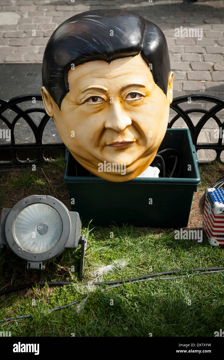 Brussels, Bxl, Belgium. 31st Mar, 2014. The mask of Chinese president seen during a protest demanding for human rights in the People's Republic of China (PRC) in Brussels, Belgium on 31.03.2014 Chinese President Xi Jinping and his wife are on a three-day visit to Belgium. European citizens, human rights activists, members of the Tibetan and Uyghur communities, Chinese activists, and Falun Gong practitioners will be demonstrating on the streets of Brussels to voice their concerns about the human rights situation in China, Xinjiang and Tibet. by Wiktor Dabkowski (Credit Image: © Wiktor Dabkow - Stock Image