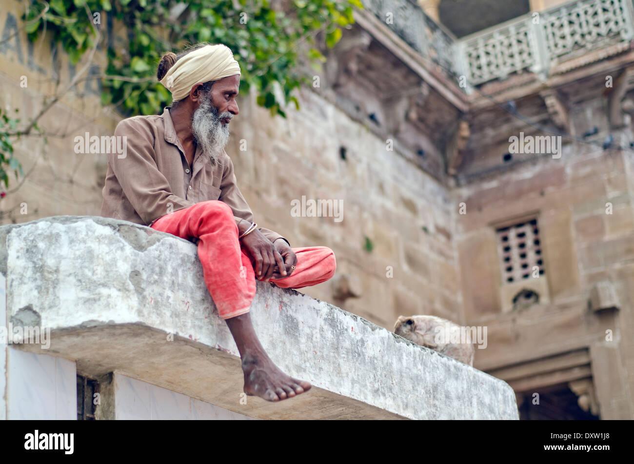 Sadhu sitting on Varanasi ghat, India Stock Photo