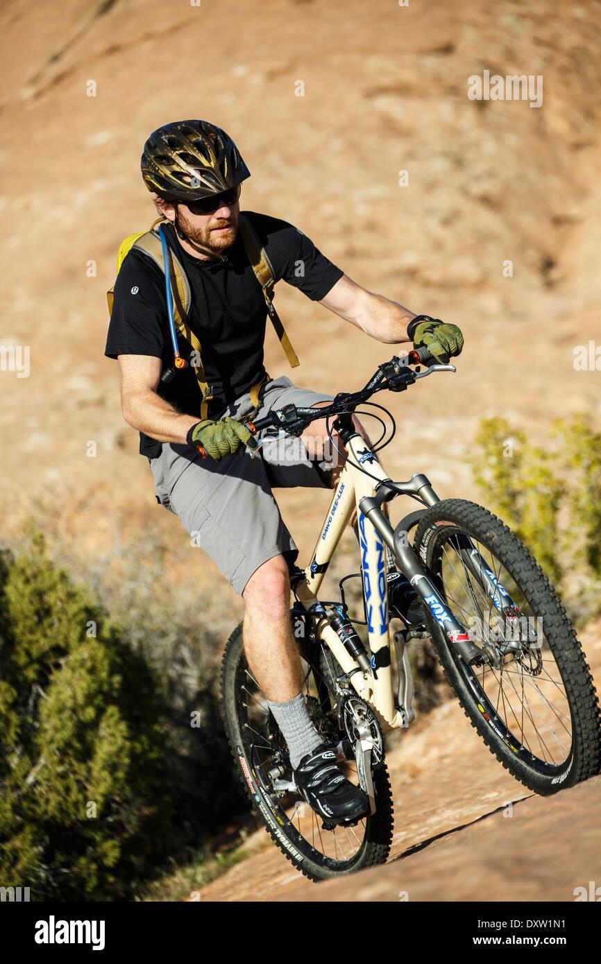 Mountain bike rider, Slickrock Trail, Sand Flats Recreation Area, Moab, Utah USA - Stock Image