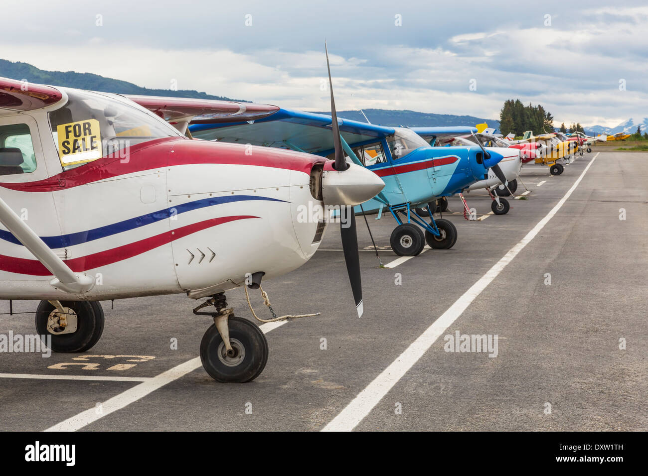 Small airplanes lined up on the tarmack in the coastal town of Homer, Alaska. - Stock Image