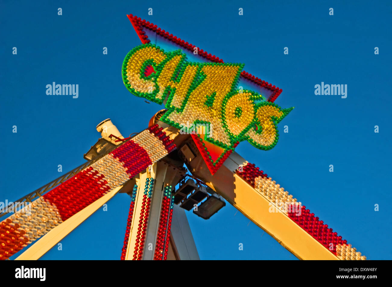 Abstract fairground ride Chaos against a blue sky at Stratford's Autumn Mop Fair - Stock Image