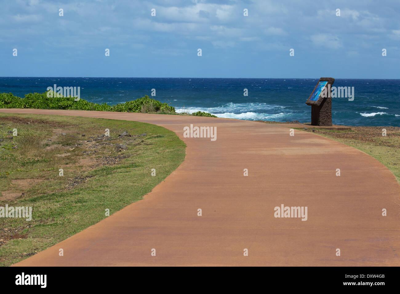 Interpretive sign on the Kauai shared-use path, Ke Ala Hele Makalae. - Stock Image