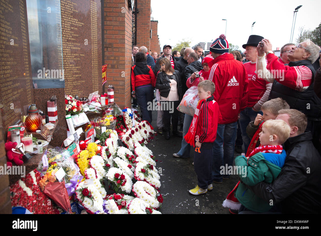 Fans lay tributes for the 96 Liverpool supporters who died at Hillsborough, Liverpool Memorial,  Anfield Stadium, Liverpool, UK - Stock Image