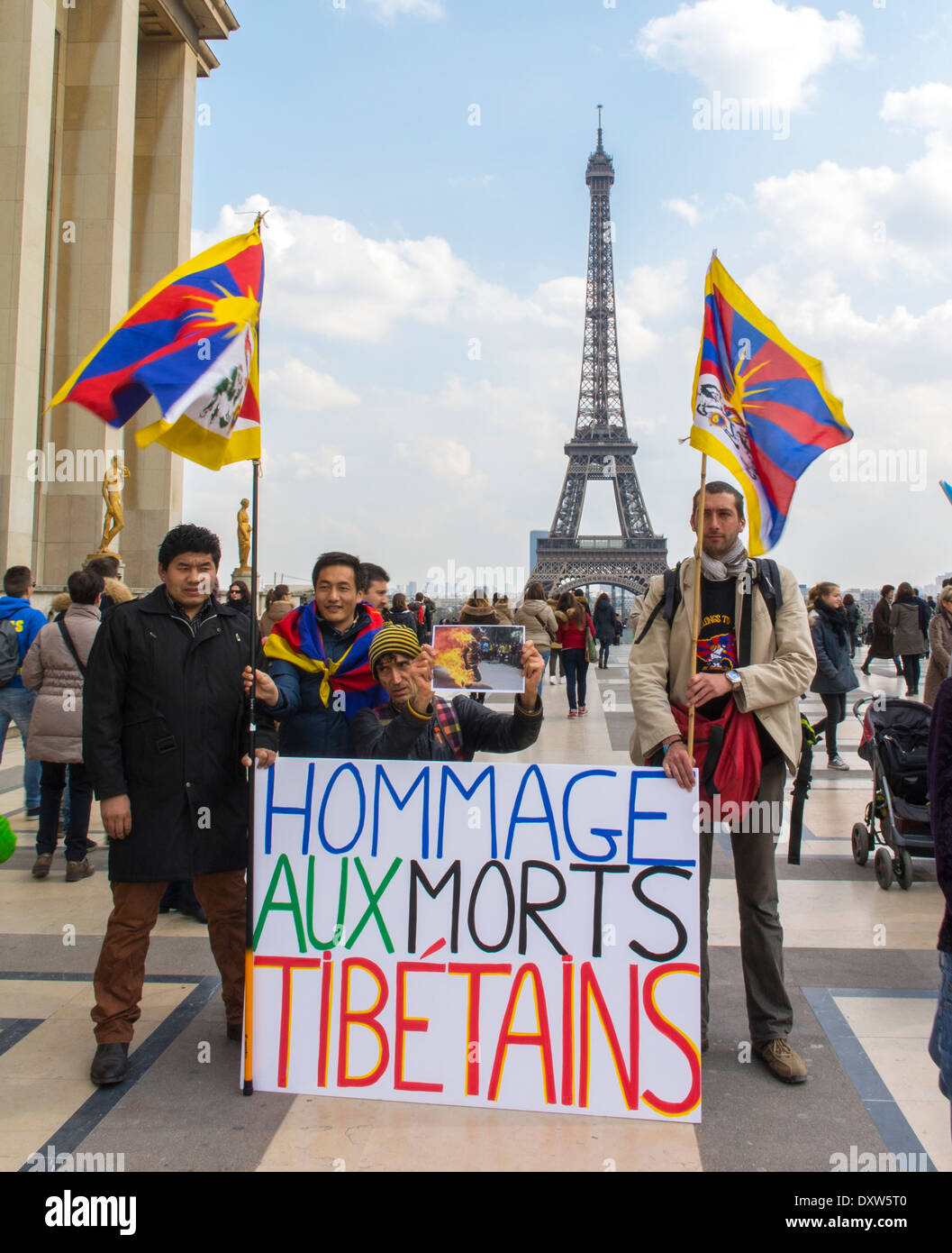 The Tibetan, Taiwanese Ethnic Communities of France, Demonstration called for French citizens to mobilize during the visit of Chinese President in Paris, on Place of the Rights of Man. Group Holding Protest signs Stock Photo