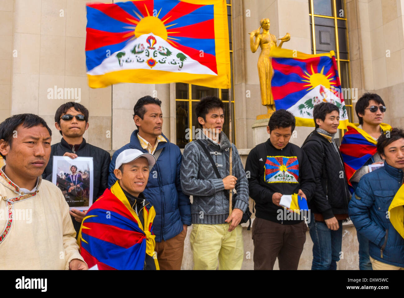 The Tibetan, Taiwanese, Ethnic Communities of France, Demonstration called for French citizens to mobilize during the visit of Chinese President in Paris, Holding Protest Signs and Flags, Citizens rights protests, solidarity youth movement Stock Photo