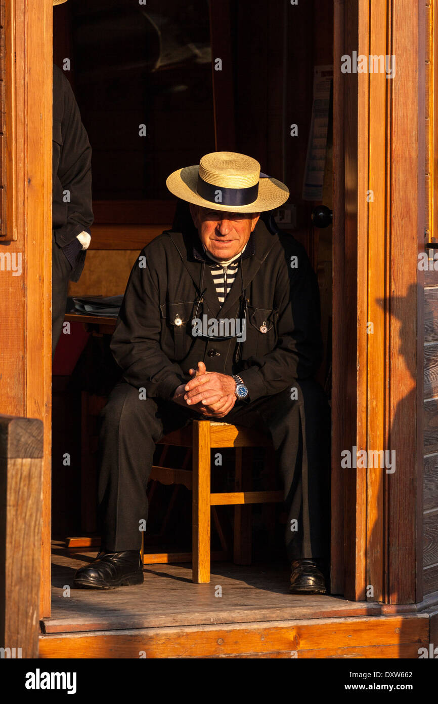 A Venetian Gondolier Waiting For Customers, Venice, Italy - Stock Image