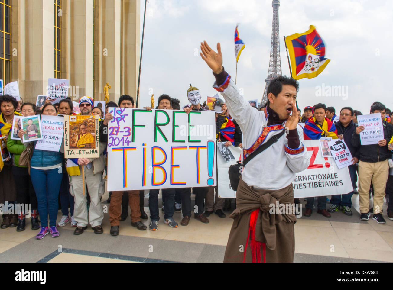 Crowd of Tibetan, Taiwanese, Ethnic Communities of France, Migrants and Friends called for French citizens to mobilize during the visit of Chinese President in Paris, Holding Protest signs Stock Photo