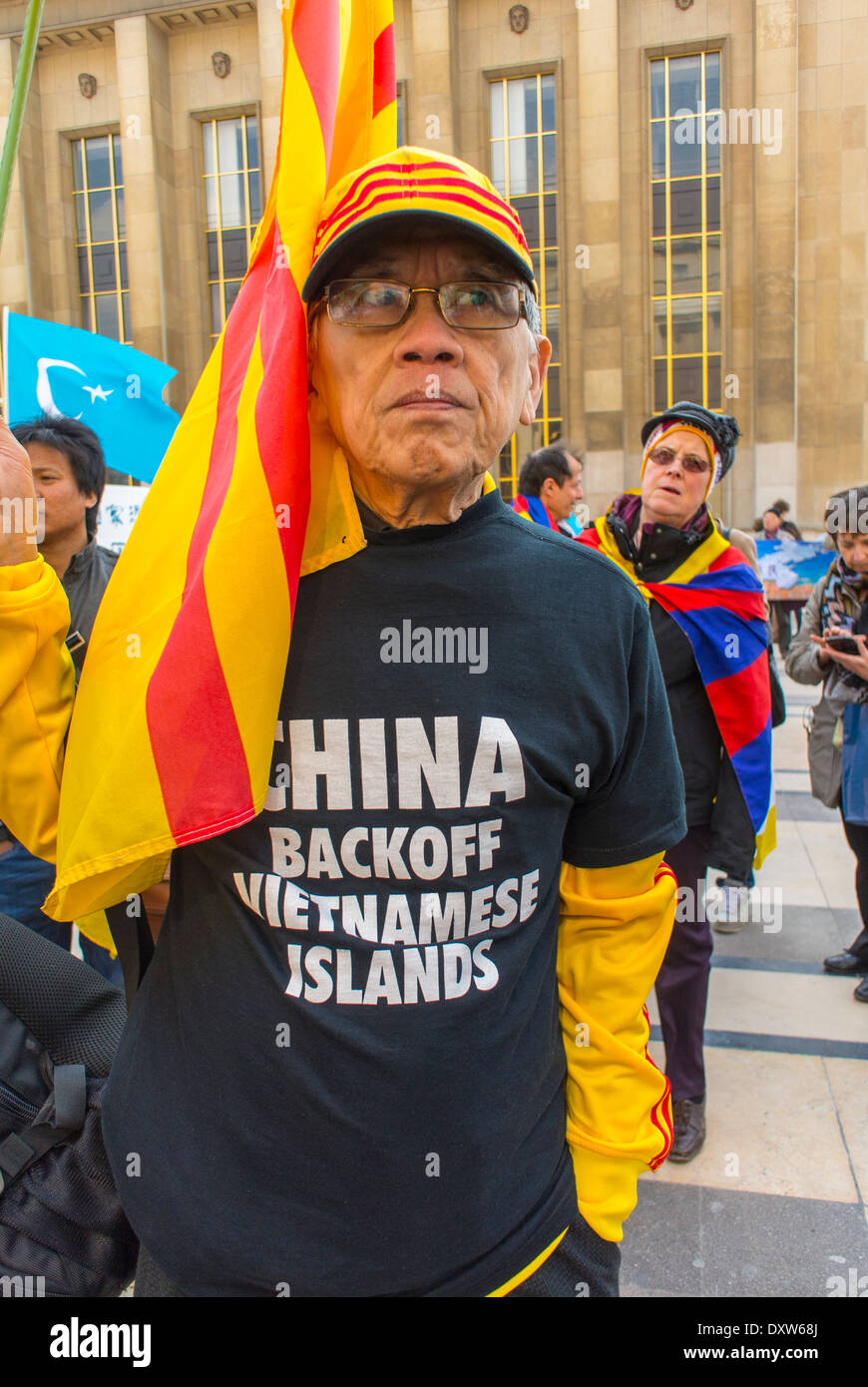 The Tibetan, Taiwanese Ethnic Communities of France, called for French citizens to mobilize during the visit of Chinese President in Paris, Man Wearing Protest Slogan t-Shirt against Island occupation Stock Photo