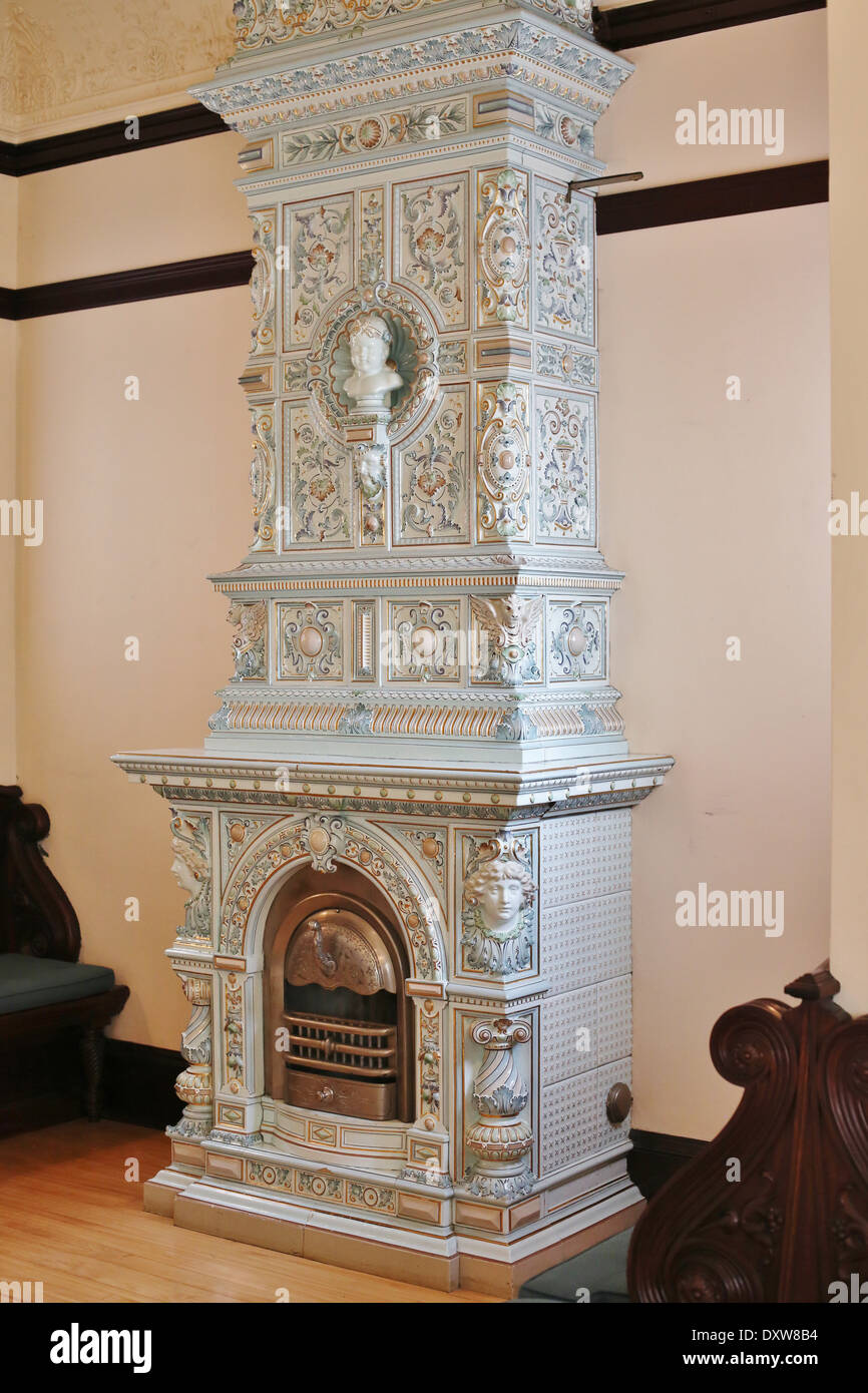 An ornate antique tiled chimney stove in the Turnblad mansion at the American Swedish Institute in Minneapolis, Minnesota. - Stock Image