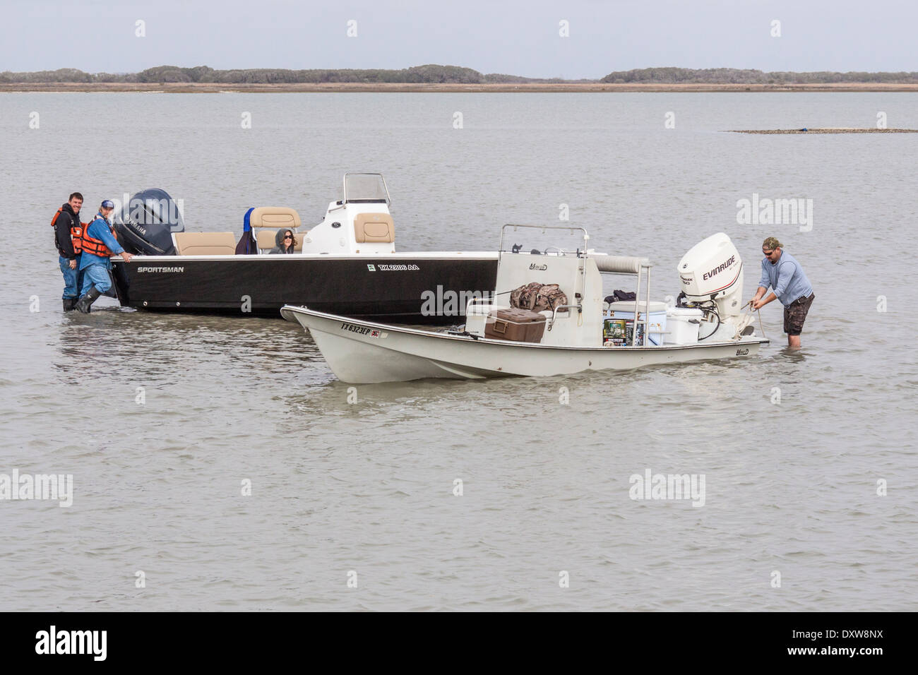 Stranded boaters in shallow waters of Aransas Pass National Wildlife Refuge - Stock Image