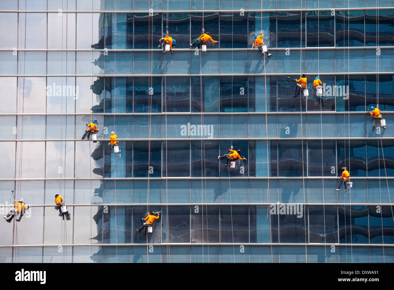 Window washers on a skyscraper in Bangkok, Thailand - Stock Image