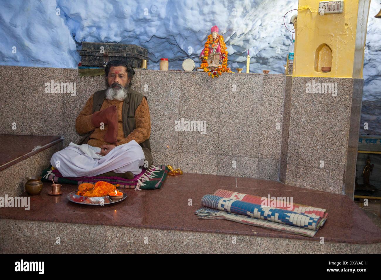 India, Dehradun. Hindu Sadhu (Holy Ascetic) in the Tapkeshwar Hindu Temple. Stock Photo