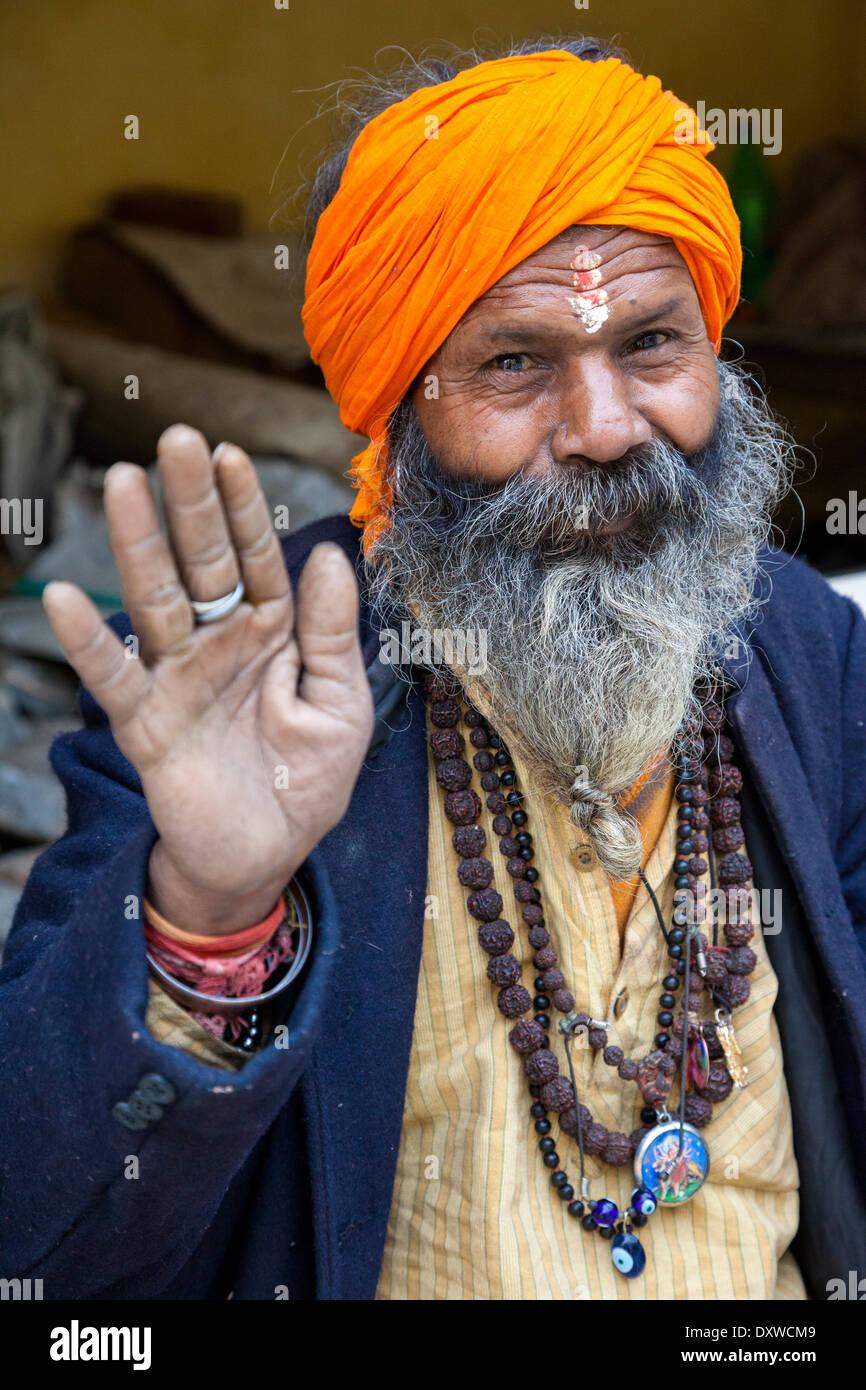 India, Dehradun. Tapkeshwar Hindu Temple. Sadhu, a Hindu Ascetic. He wears a mala (rosary) of rudraksh seeds. - Stock Image