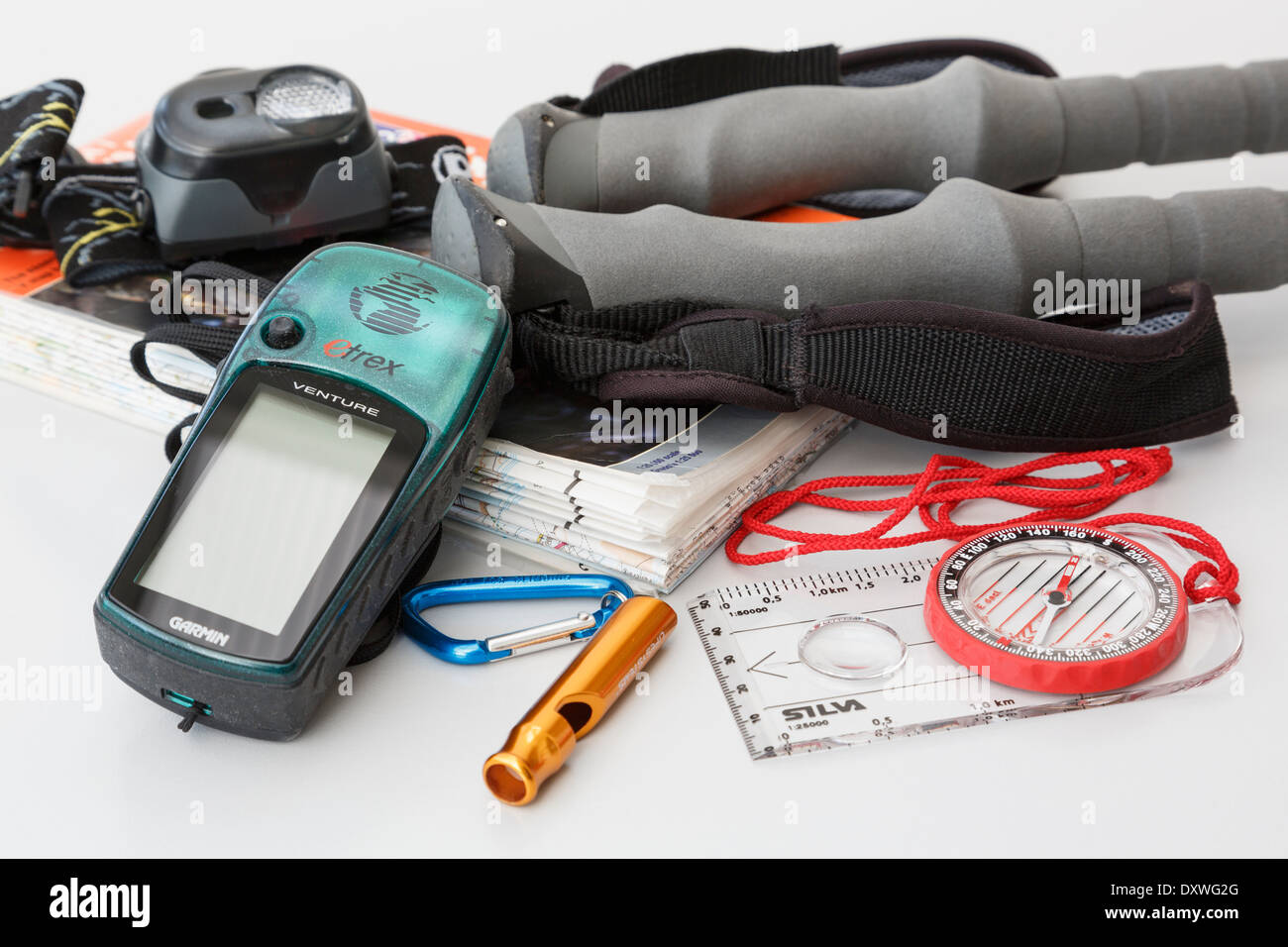 Walking and hiking equipment with Ordnance Survey map, navigation compass, Garmin Etrex GPS, safety whistle, head torch and trekking poles. England UK - Stock Image