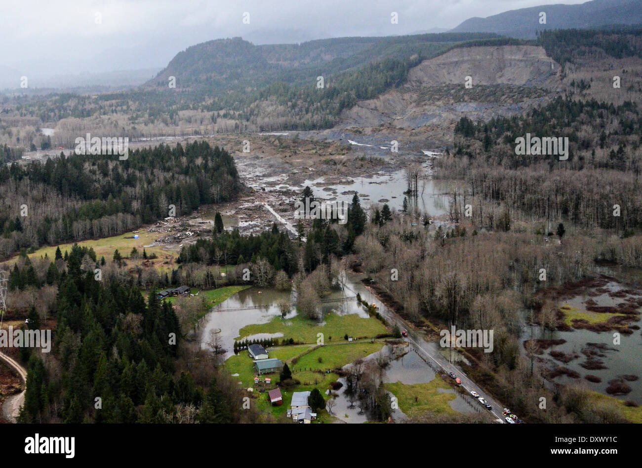 Aerial view of the aftermath of the mudslide more than a week after it occurred along highway 530 killing at least 28 people and destroyed a small riverside village in northwestern Washington state March 31, 2014 in Oso, Washington. - Stock Image