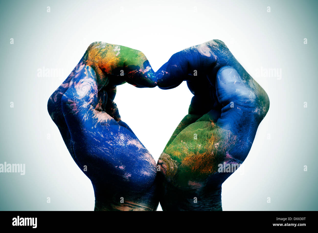 A world map in man hands forming a heart earth map furnished by a world map in man hands forming a heart earth map furnished by stock photo 68185288 alamy gumiabroncs Gallery