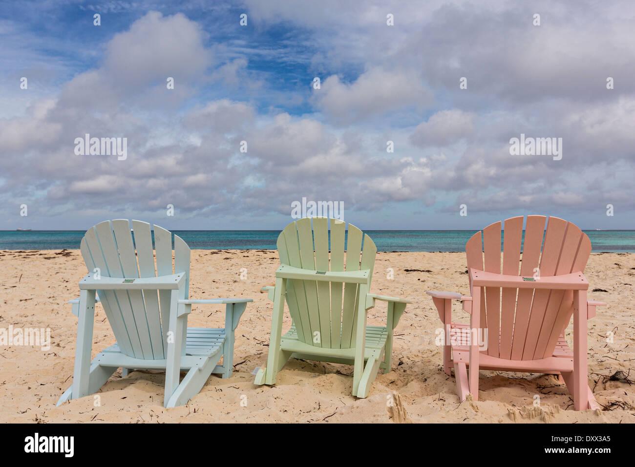 Pastel colored adirondack chairs on Love beach in Nassau ...