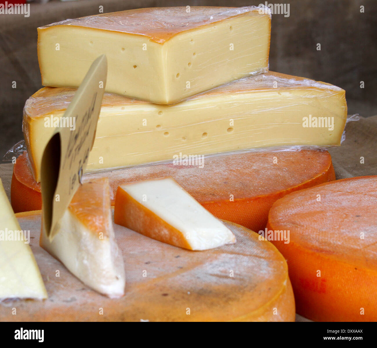 excellent yellow cheese on sale from milkman into a village fair 2 - Stock Image