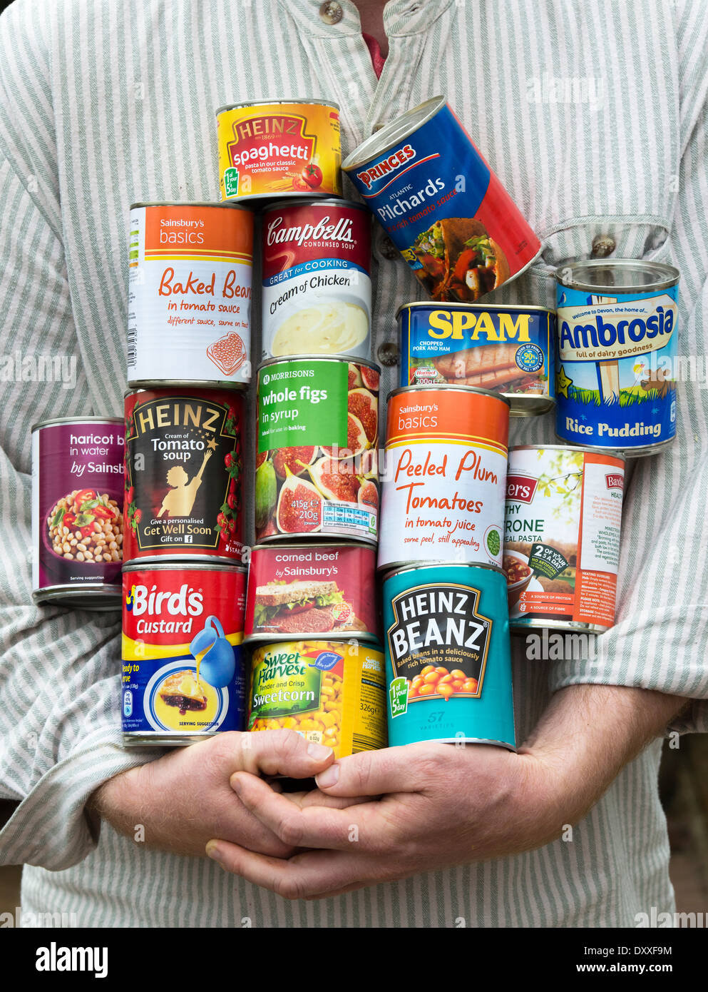 Man holding tins of food - Stock Image