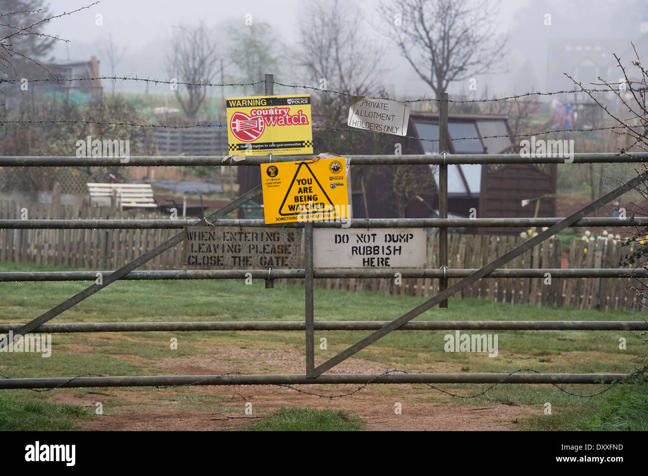 Security signs on a gated village allotment . Bodicote, Banbury Oxfordshire. UK - Stock Image