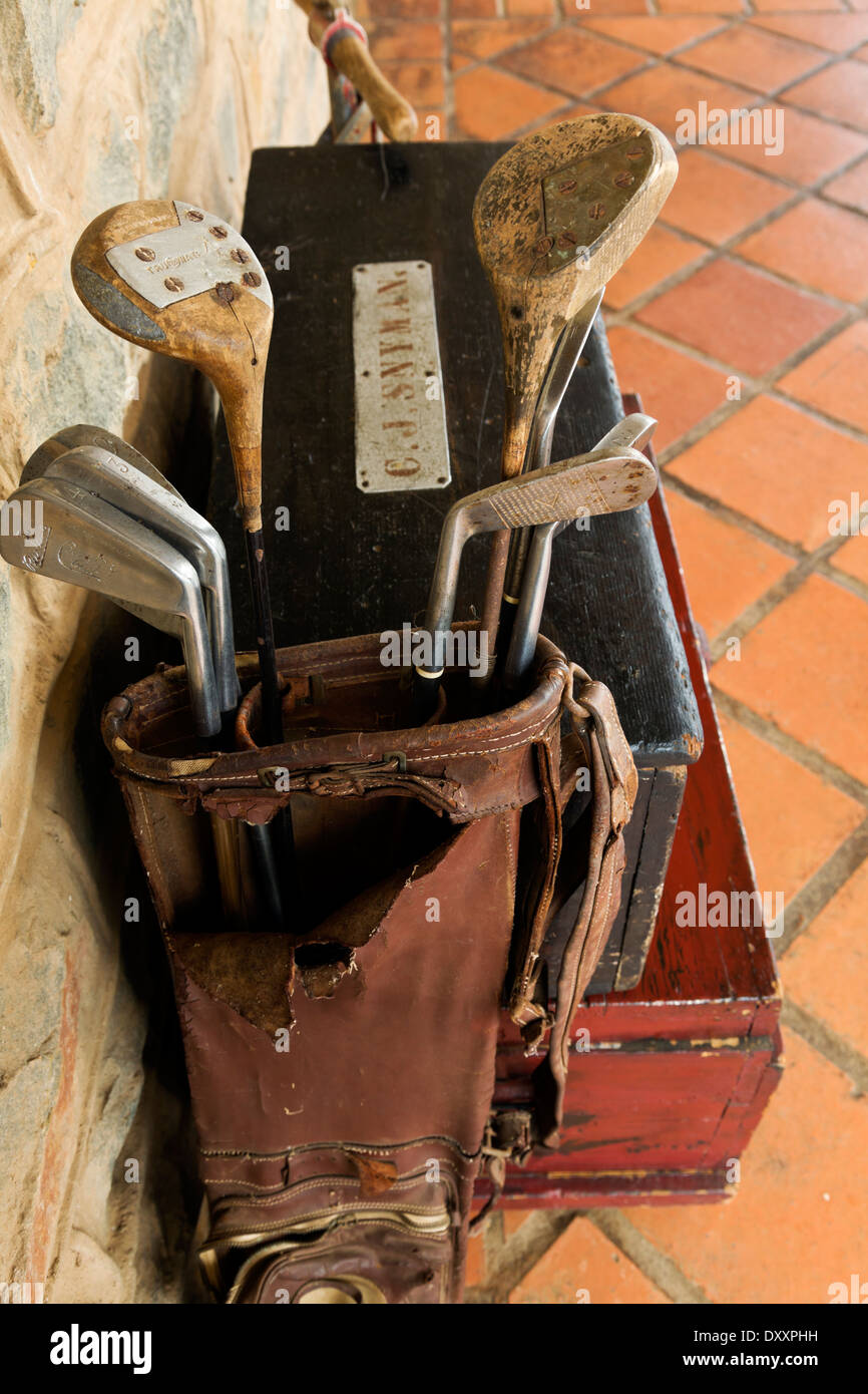 A Set Of Vintage Golf Clubs Resting On A Pair Of Trunks Stock Photo