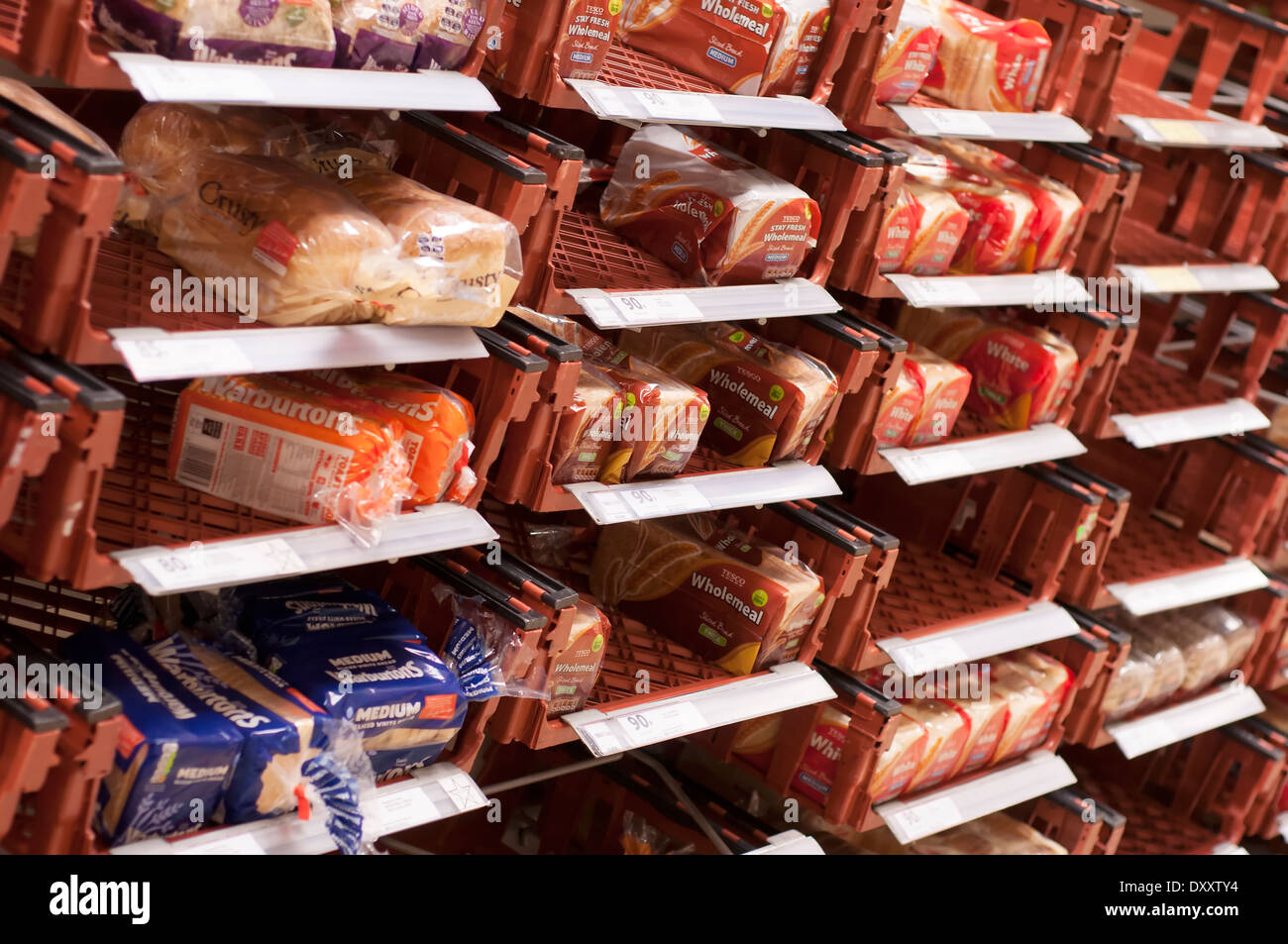 Loaves of bread on supermarket shelves - Stock Image
