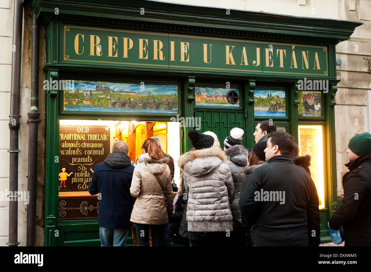 People queuing to buy traditional Czech Trdelnik pastries in Prague January 2014 - Stock Image