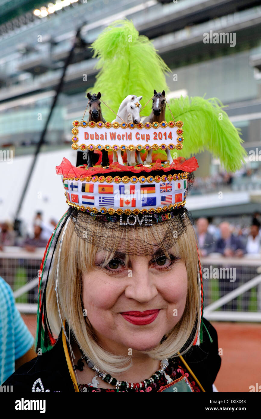 Lady with hat at Dubai World Cup horse racing championship at Meydan racecourse in Dubai United Arab Emirates - Stock Image