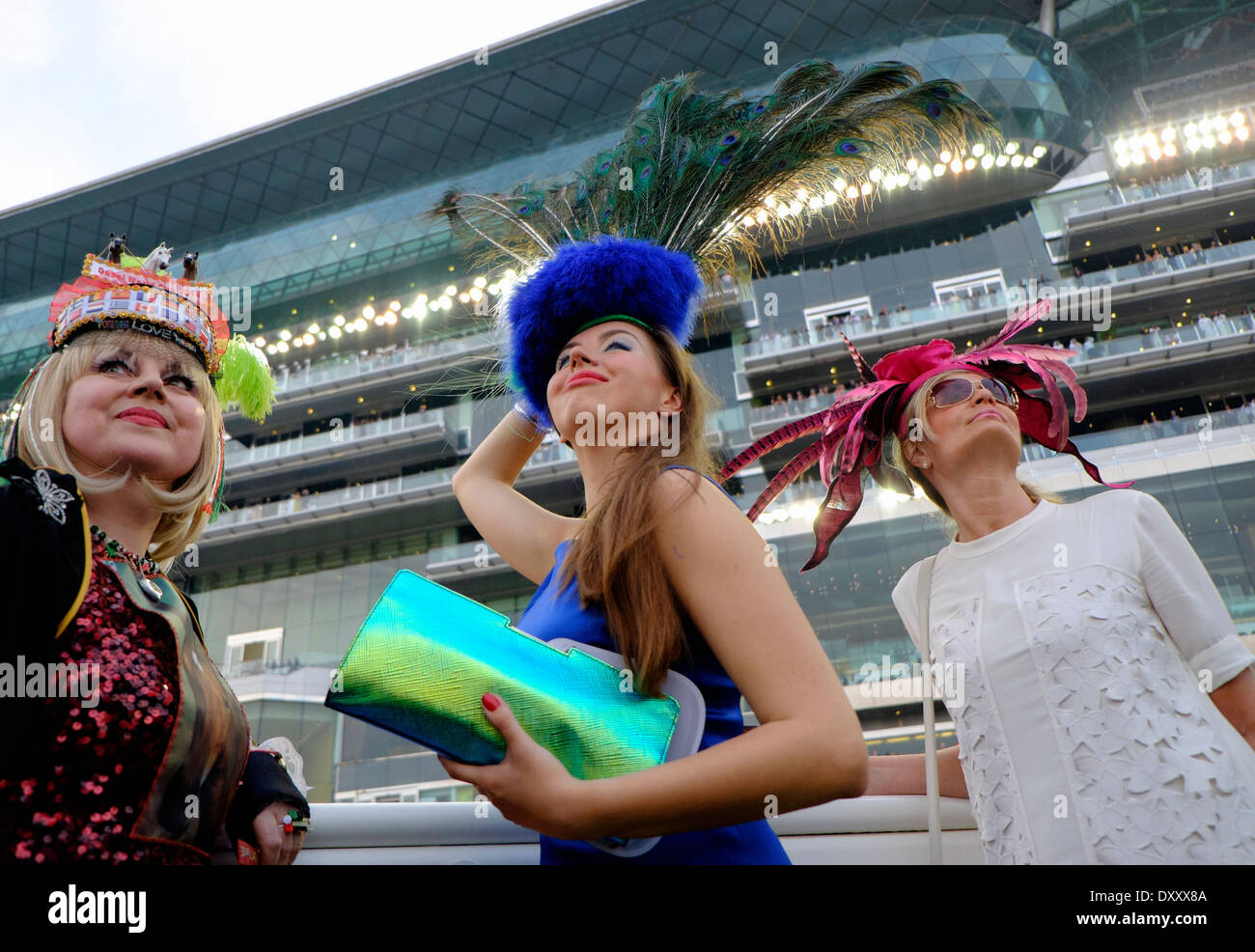 Three fashionable ladies at the Dubai World Cup horse racing championship at Meydan racecourse in Dubai United Arab Emirates - Stock Image