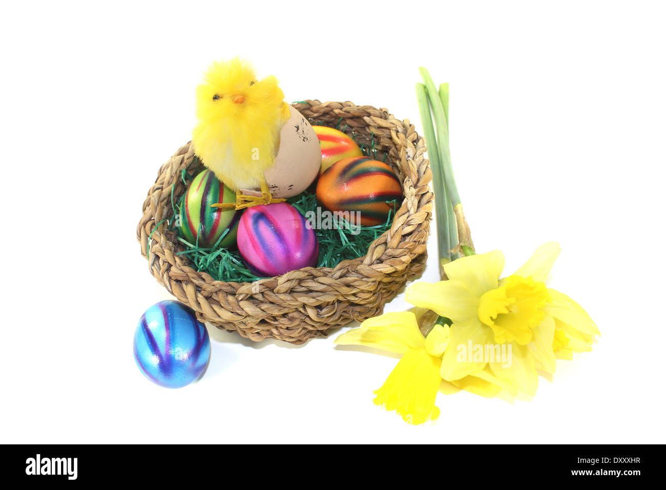 Easter Basket with chick on a light background - Stock Image