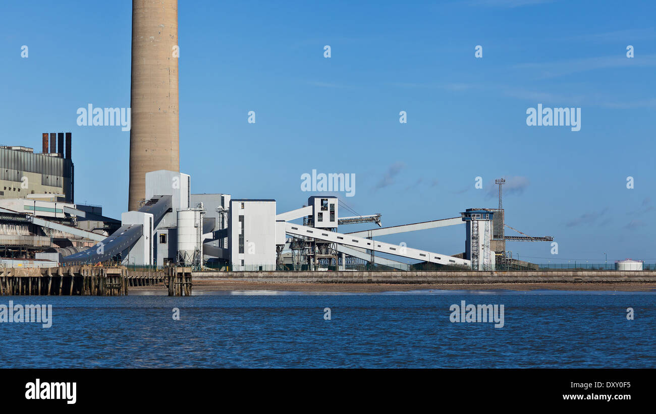 Chimneys and conveyor belts in factories near Sheerness (color image) - Stock Image