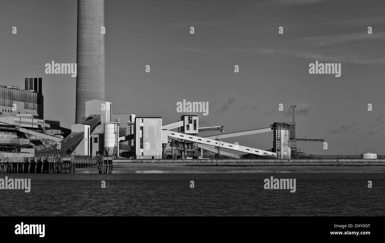 Chimneys and conveyor belts in factories near Sheerness (black and white image) - Stock Image